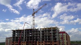 Construction of the building on the background of sky and clouds time lapse. 4 k. Under construction apartments on. Time-lapse Workers building a new house stock video footage
