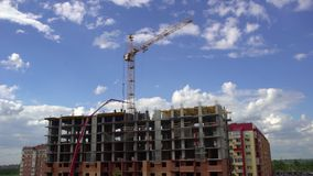 Construction of the building on the background of sky and clouds time lapse. 4 k. Under construction apartments on. Time-lapse workers building a new house stock video