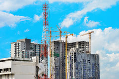 Construction of building in bangkok with blue sky Stock Photos