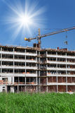 Construction of building a beautiful sky with sun as background Stock Image