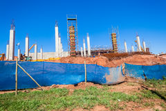 Construction Building Concrete Columns. New building site for shopping mall with concrete columns being constructed with concrete and steel in Waterfall district Stock Photo