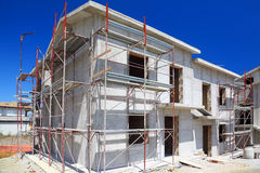 Construction of building of concrete house. Construction of building of new two-story white concrete house with stairs and balcony Stock Images