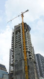 Construction building. With crane against blue sky Stock Images