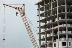 Construction of the building with crane. Royalty Free Stock Image