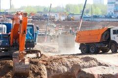 Construction, building, development, constructing. Naberezhnye Chelny, Tatarstan, Russia, Excavators digging the pit. construction, building, development Stock Photo