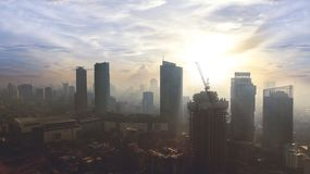 Construction building in Jakarta city. JAKARTA - Indonesia. May 21, 2018: Aerial view of Jakarta cityscape with new building under construction at sunrise time Stock Image