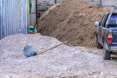 Construction building material with blue bucket and hoe Royalty Free Stock Image