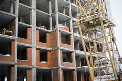 The construction of the building of red brick. The construction of the building made of red bricks and blocks Stock Images