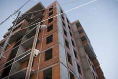 The construction of the building of red brick. The construction of the building made of red bricks and blocks Stock Photos