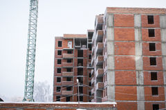 The construction of the building of red brick. The construction of a tall building of red bricks and blocks Stock Images