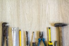 Construction, building and repair tools set for house work on wooden background. Top view. royalty free stock image