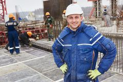 Construction building site foreman. Happy construction manager or building site foreman worker royalty free stock photo