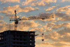 Construction of the building at sunset Stock Images