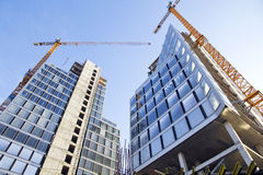 Construction of buildings. Buildings construction process with cranes