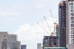 Construction of buildings and the sky with clouds. Construction of buildings in the capital and the sky with clouds royalty free stock images