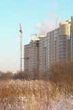 Construction of buildings. Construction of high-rise buildings on the outskirts of the city in winter Stock Image