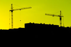 Construction. Of buildings, two cranes, black and yellow background Stock Photography