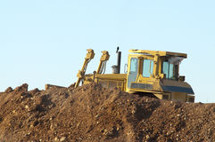 Construction bulldozer. A construction bulldozer moving dirt on a road building job stock photos