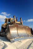 Construction Bulldozer. Yellow construction bulldozer over sand Stock Photos