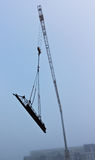 Construction Business in Crisis. Photograph of a construction crane taken during a foggy morning Royalty Free Stock Image