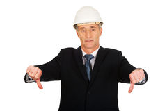 Construction businessman showing thumbs down Stock Images