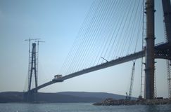 Construction of the cable-stayed bridge. Cable-stayed pylon in foreground Royalty Free Stock Image