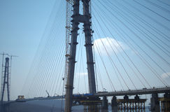 Construction of the cable-stayed bridge. Cable-stayed pylon in foreground Royalty Free Stock Photos