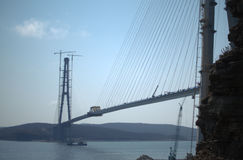 Construction of the cable-stayed bridge. Cable-stayed pylon in foreground Royalty Free Stock Photo