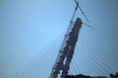 Construction of the cable-stayed bridge. Cable-stayed pylon in foreground Stock Image