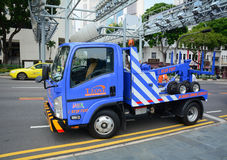 Construction car running on street in Singapore Stock Images