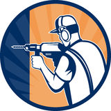 Construction carpenter drilling. Illustration of a Construction worker carpenter with drill drilling set inside a circle done in retro style Stock Photography