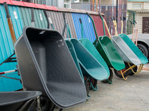 Construction carts of different colors stock images