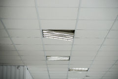 The construction of the ceiling, a broken Ceiling lamp Stock Images