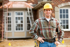 Construction: Cheerful Worker on Construction Site Stock Photo