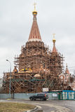 Construction of the Church of All Saints at Filevskaya floodplain. Moscow. A new church is being built in a densely populated residential area of Moscow. The stock image