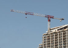 Construction climbing crane and building. Royalty Free Stock Photography