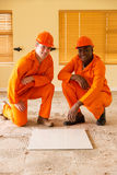 Construction co-workers doing renovations Royalty Free Stock Photo