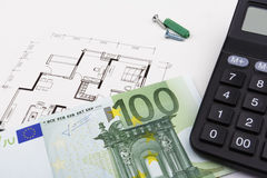 Construction concept with Euros (EUR). Construction concept with a 100 Euro bill, a blueprint and a caculator Stock Image
