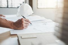Construction concept, Hands of architect or engineer working for royalty free stock photos