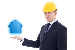 Construction concept - handsome business man or architect in yel Royalty Free Stock Photography