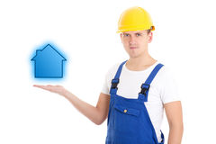 Construction concept - man builder in uniform and helmet holding Royalty Free Stock Photo