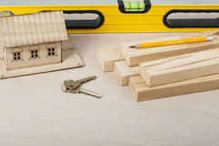 Construction concept, model house,work tools, keys.Copy space for text. Royalty Free Stock Photos