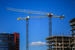 Construction concept. A new building under construction against the sky. Blue background. New urban city. Machinery Stock Image