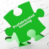 Construction concept: Prefabricated Housing on puzzle background. Construction concept: Prefabricated Housing on Green puzzle pieces background, 3D rendering royalty free illustration