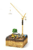 Construction concept. Construction site with construction machinery, materials and tower crane on the piece of ground. 3d illustration Royalty Free Stock Photo