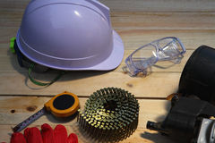 Construction concept  working tools. Construction concept with hard hat working tools and wood background Stock Photography