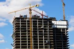 Construction of a concrete building. Construction of a concrete structure. Construction site with cranes royalty free stock photos