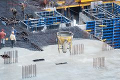Construction of concrete foundation of new building. Aerial view of construction site workers leveling cement in. Building site Royalty Free Stock Photography