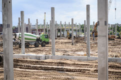 Construction. Concrete poles at the construction site of industrial building Royalty Free Stock Image