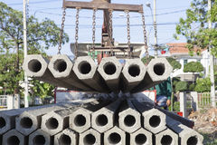 Construction concrete root pole on lifting crane preparing to co Royalty Free Stock Photos